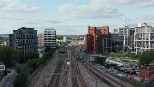 Forwards Tracking of Train Slowly Driving on Track Leading Around Modern Residential Buildings in