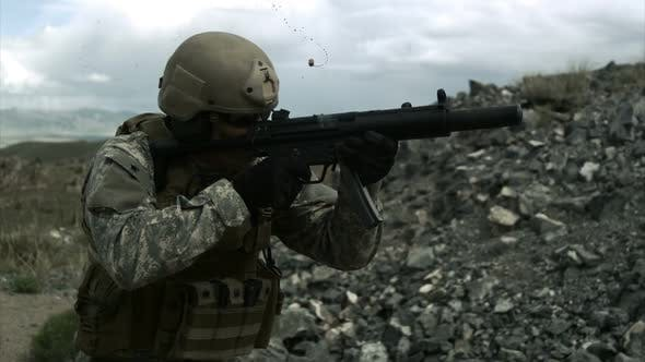 Thumbnail for Slow motion clip of soldier shooting automatic weapon.