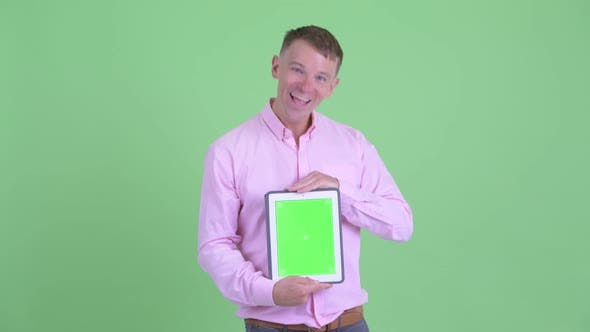 Thumbnail for Happy Businessman Showing Digital Tablet and Looking Surprised