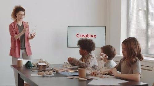 Woman Showing Framework Model to Class
