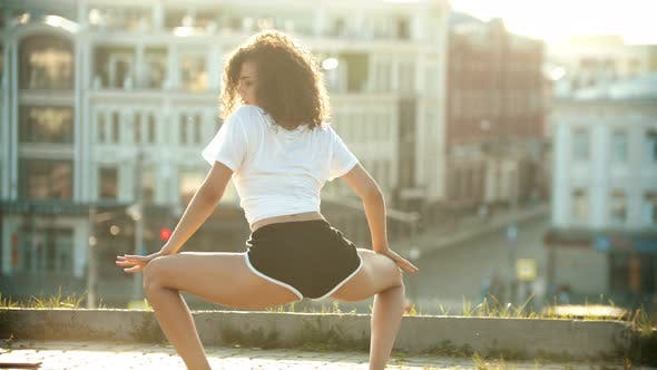 Attractive Young Woman Dancing Twerk on the Roof - Sunset