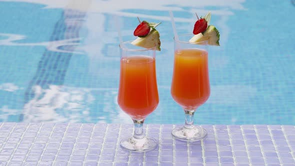 Thumbnail for Two cocktails by pool . Shot on RED EPIC for high quality 4K, UHD, Ultra HD resolution.