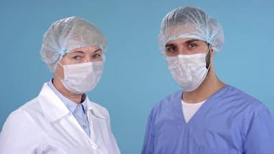 Doctors in Uniforms Looking at Camera