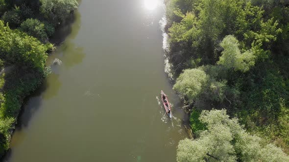 An Aerial View. Two in a Kayak, Merging on the Amazon. The River and the Banks Are Overgrown with