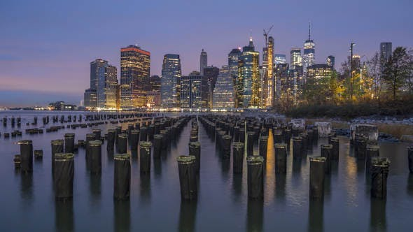 Cityscape of Lower Manhattan and River with Piers in the Morning. New York City