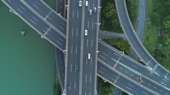 Thumbnail for Aerial Drone View of Highway Multi-level Junction Road with Moving Car at Sunset, Active Movement