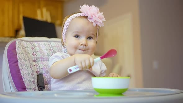 Thumbnail for Smiling Baby Eating Food On Kitchen