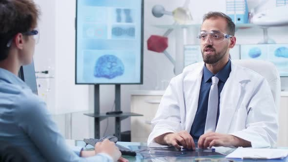 Thumbnail for Physician Wearing Augmented Reality Glasses Showing Something To a Patient
