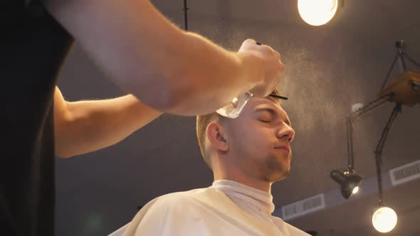 Thumbnail for Close Up of Young Hairstylist Spraying Water on Male Hair From Sprayer After Cutting in Salon