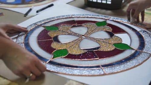 Two Artists Assemble a Composition From Stainedglass Windows