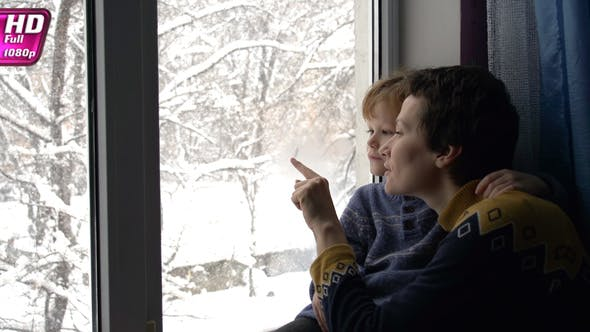 Thumbnail for Family Admiring Christmas Snowfall