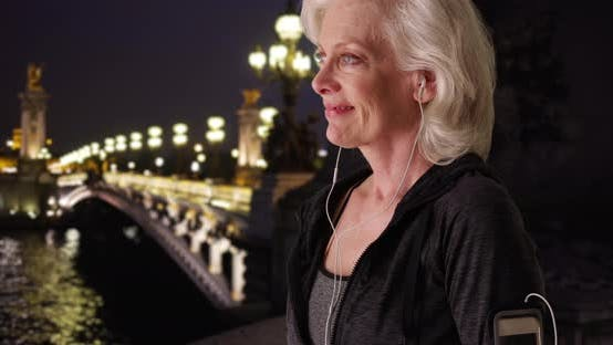 Thumbnail for Close up of active senior woman working out on Paris vacation at night
