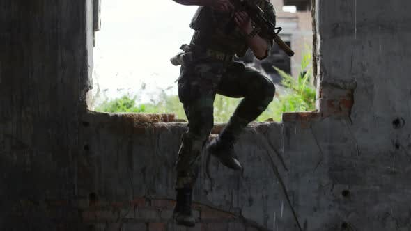 Thumbnail for Armed Soldier Getting into Abandoned Building