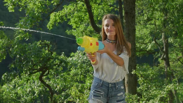 Thumbnail for Girl with a water pistol