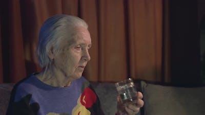 Grandma drinks water