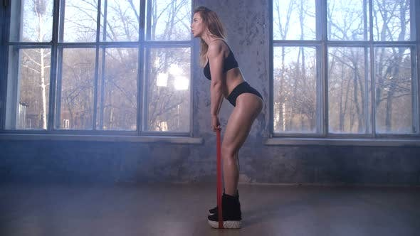 Cover Image for Fitness Woman Doing Deadlift Using Resistance Band