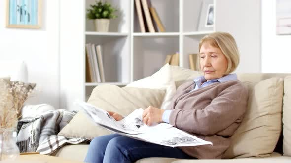 Thumbnail for Old Woman Reading Newspaper
