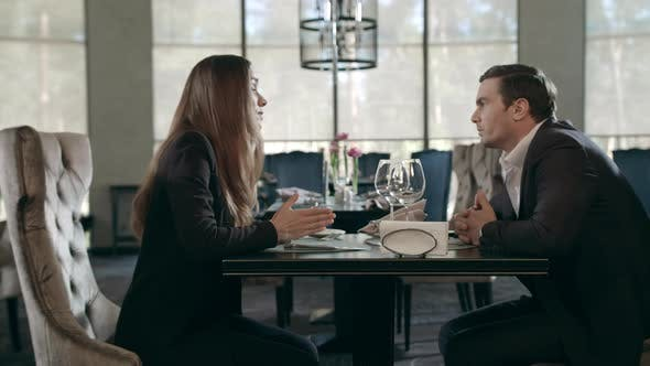 Thumbnail for Business Couple Talking at Restaurant. Business Man and Woman Meeting in Cafe
