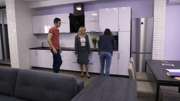 Thumbnail for Female Estate Agent Showing Apartment To Couple