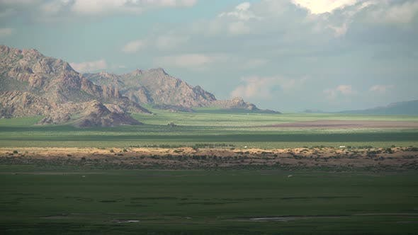 Desert Sand Dunes Among Green Fresh Meadows