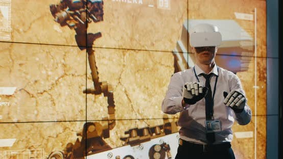 Thumbnail for Technician Using VR Headset and Exoskeleton Gloves