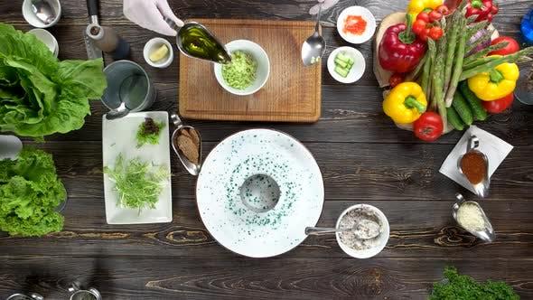 Hands Preparing Garnishing Food