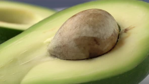 Thumbnail for Avocado Slices Closeup, Macro Food Summer Background, Fruits Top View. Rotate