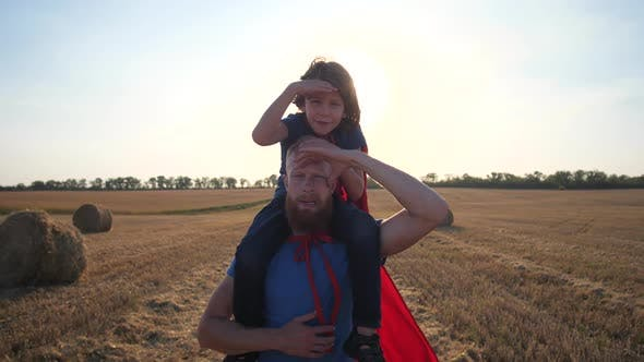 Thumbnail for Dad Carrying Son on Shoulders Walking Across Field
