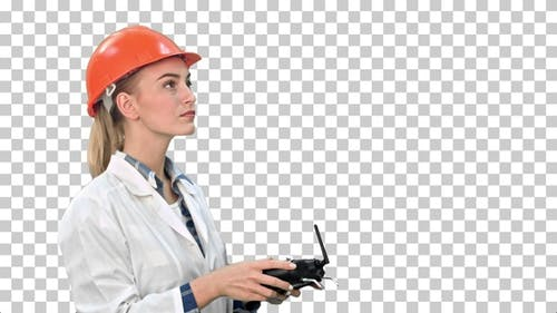 Female construction worker operating a, Alpha Channel