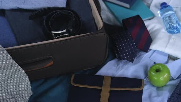 Thumbnail for Business Travel Background: Businessman's Suitcase Ready for Business Trip