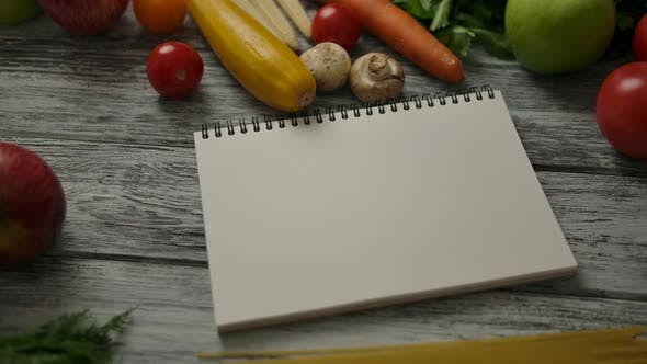 Thumbnail for Blank Notepad Amidst Vegan Food on Table
