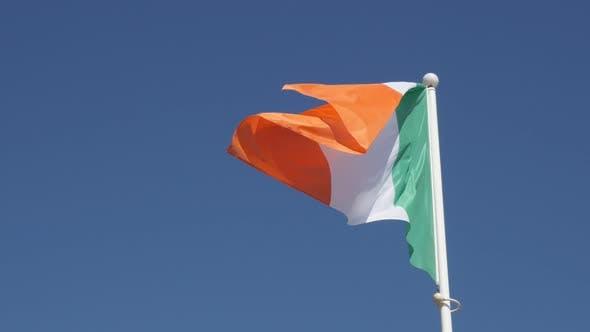 Thumbnail for Ireland flag tricolour stripes against blue sky waving on wind 4K 2160p 30fps UltraHD footage - Shin