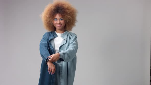 Mixed Race Black Woman with Big Afro Hair in Studio Alone Wears a Denim Shirt