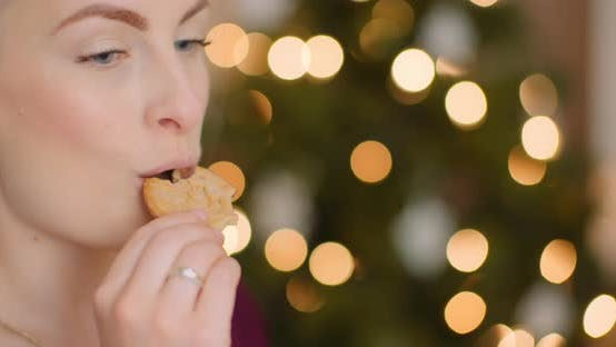 Young Woman Enjoying Fresh Baked Cookie