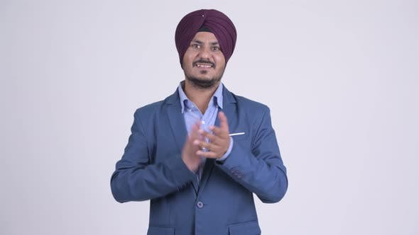 Thumbnail for Happy Bearded Indian Sikh Businessman Clapping Hands