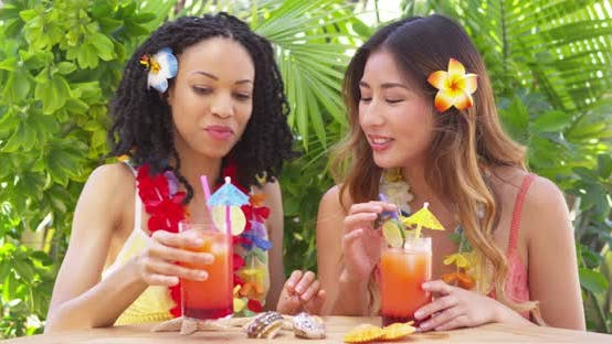 Thumbnail for Best friends on vacation listening to sea shells and drinking cocktails