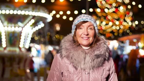 Thumbnail for Happy Senior Woman Smiling at Christmas Market 20