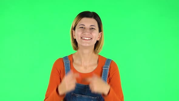 Cover Image for Trendy Girl Poses for Camera Makes Funny Faces. Green Screen