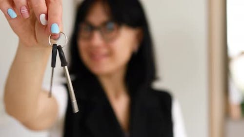Real Estate Agent Woman Giving Keys to Customer After Selling Modern Apartment
