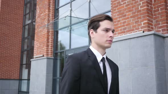 Thumbnail for Walking Businessman in Suit, Leaving Office in Slow Motion