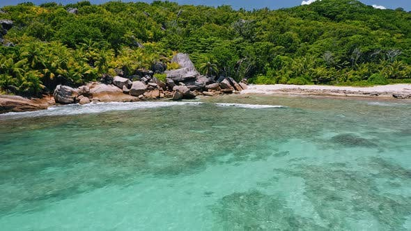 Thumbnail for Aerial View of Remote Tropical Paradise Beach Anse Coco on La Digue. White Sand Beach with Shallow