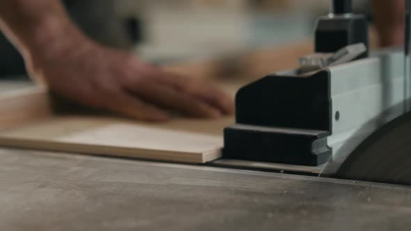 Thumbnail for Saws Furniture Details with a Circular Saw. Close Up View of Man Wooden Production Factory Furniture