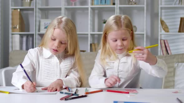 Thumbnail for Blonde Twins Drawing Pictures at Preschool