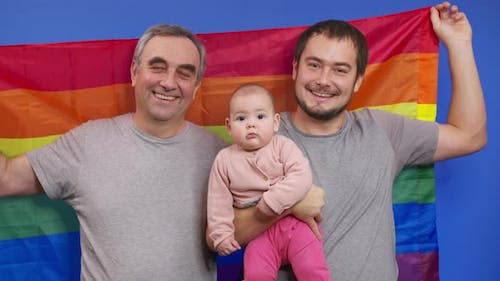 Authentic Shot of Happy Homosexual Male Gay Family with Adopted Toddler Baby Girl Is Smiling in