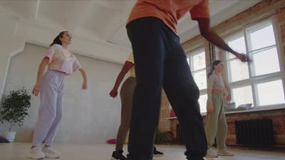 Young People Dancing with Teacher in Studio