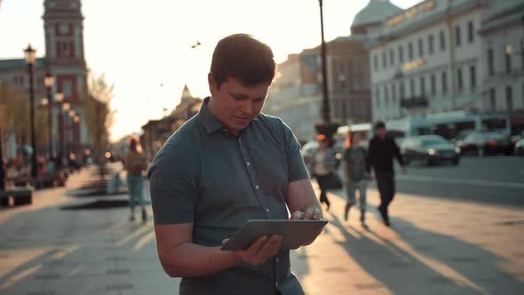 Thumbnail for Young Caucasian Man Navigate in City Using Tablet Pc Computer