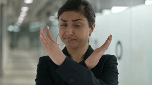 Thumbnail for Serious Indian Businesswoman Saying No By Arms Crossed