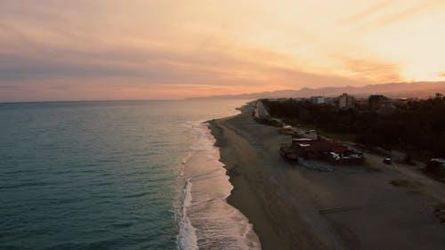 Coast with Orange Sky