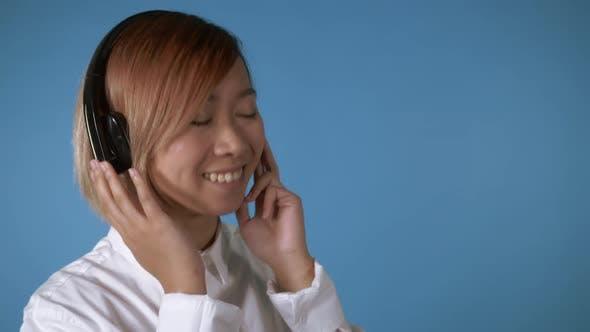 Thumbnail for Happy Girl Listening Music Earphones