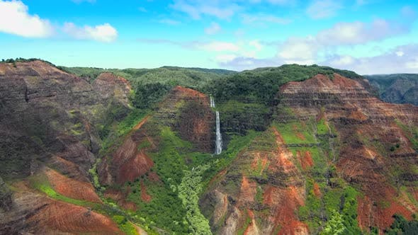 Aerial view of jurssic falls at Waimea Canyon In Kauai Island